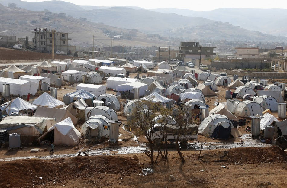A general view shows tents of Syrian refugees at al-Shouhada camp at the Lebanese border town of Arsal, in the eastern Bekaa Valley - (Reuters)