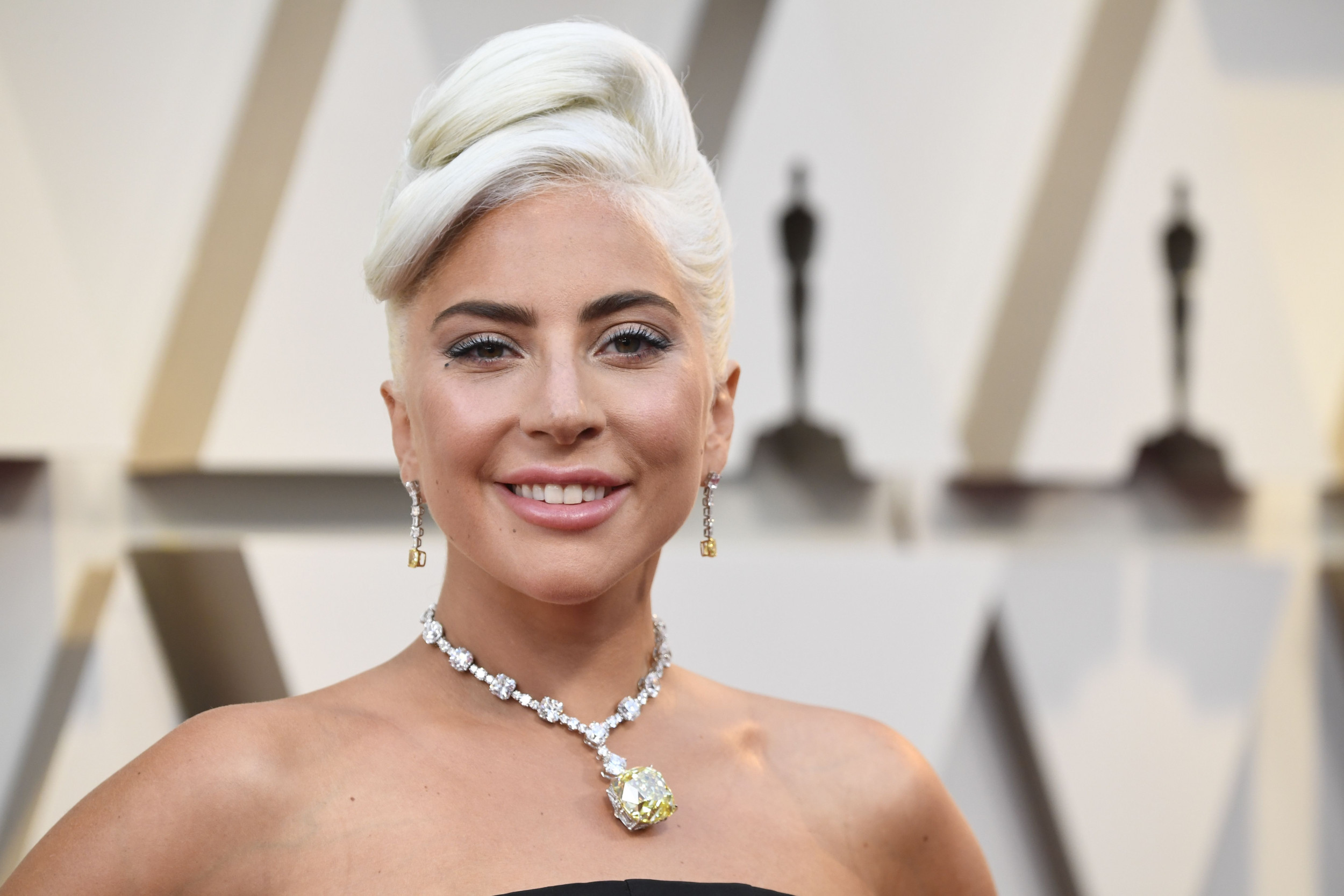 "Lady Gaga brands Donald Trump ""racist"" and ""a fool"" as she expresses outrage over death of George Floyd"