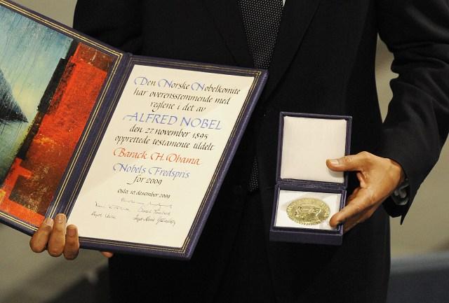 Barack Obama Poses with His Nobel Prize