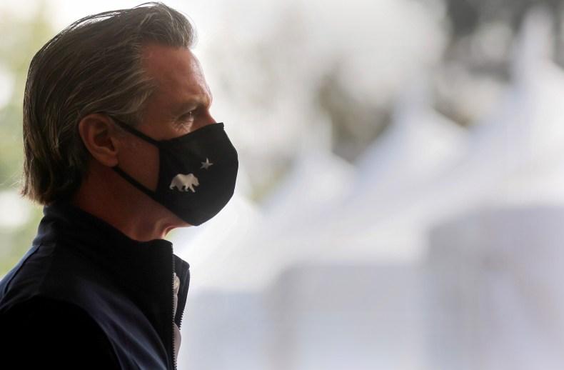California Governor Gavin Newsom enters a press