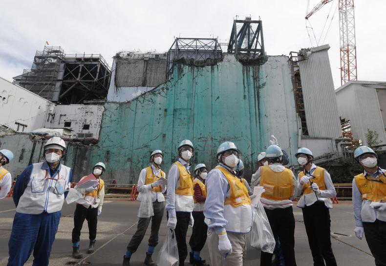 People wear face masks at Fukushima
