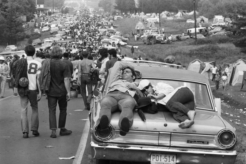 Couple Sleeping on Car at Woodstock