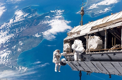Astronauts during a space walk outside the International ...