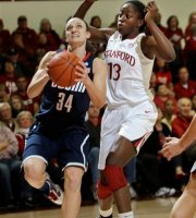 Connecticut guard Kelly Faris (34) goes to the basket in front of Stanford forward Chiney Ogwumike (13) in the first half of an NCAA college basketball game in Stanford, Calif., Thursday, Dec. 30, 2010.