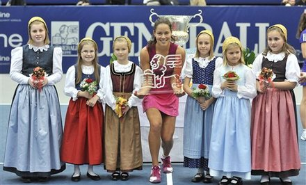 Serbia's Ana Ivanovic, Center,  Pose With Children In Typical Austrian Dresses