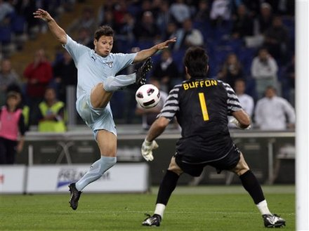 Lazio forward Mauro Zarate, of Argentina, left, tries to score past Juventus goalkeeper Gianluigi Buffon during the Serie A soccer match between Lazio and Juventus, in Rome's Olympic stadium, Monday, May 2, 2011.