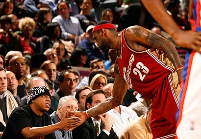 Jay-Z chats up LeBron James during a game this season.