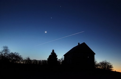 In a rare alignment, the crescent moon, and the planets Venus, ...