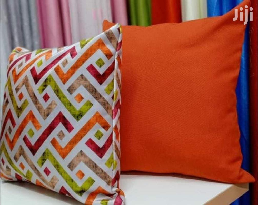green and orange throw pillows
