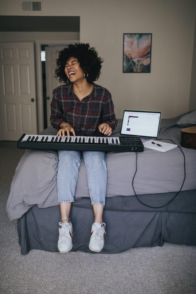 woman playing keyboard and singing