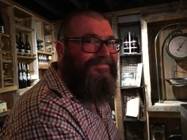 David sitting at the bar at Olivigna