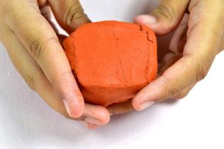 Take clay in your hands