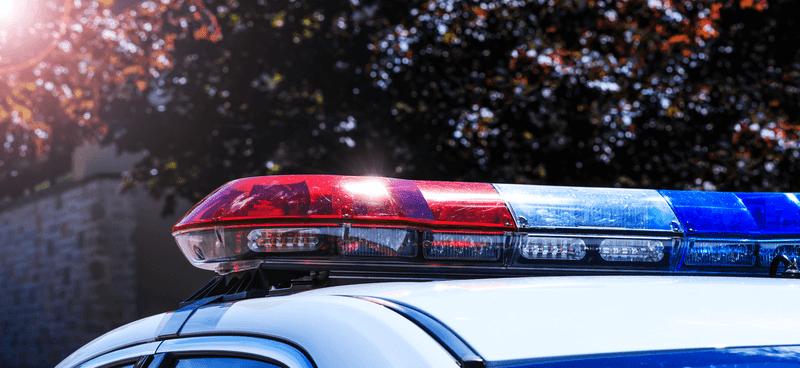 police lights flashing over car