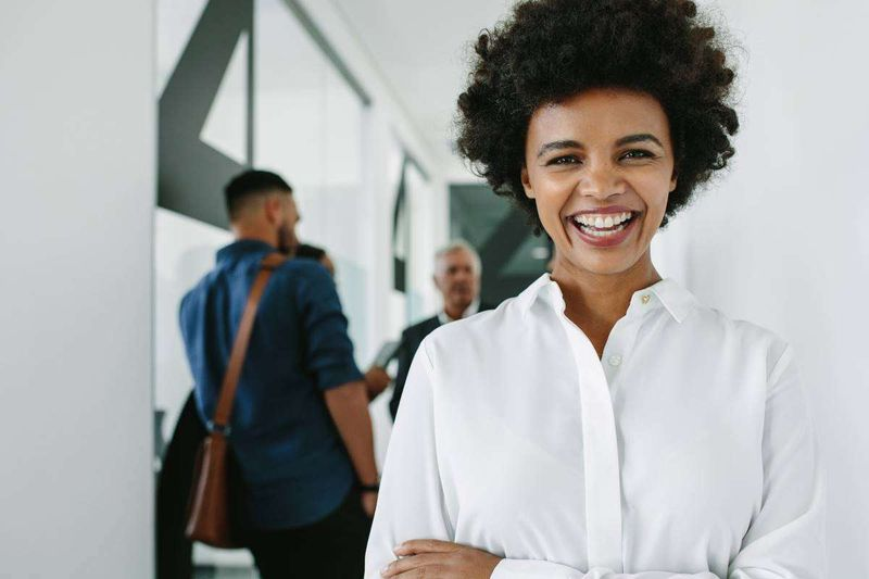 smiling professional woman after successful meeting   immigrate to Canada