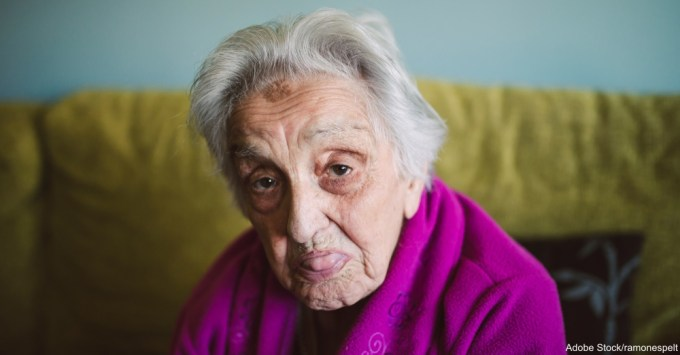 Elderly woman sticking out her tongue