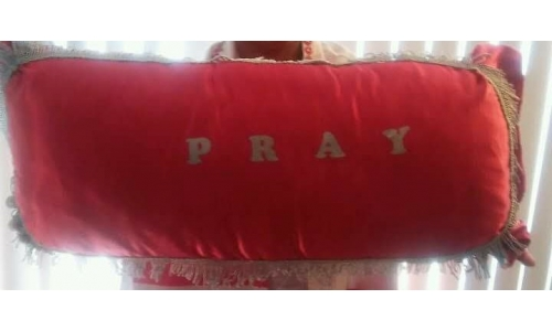 red kneeling prayer pillow with gold