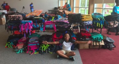 'Little Miss Flint' helps donate supplies to over 1,000 students