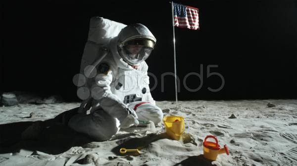 SLO MO WS ZO of an astronaut sitting on the moons