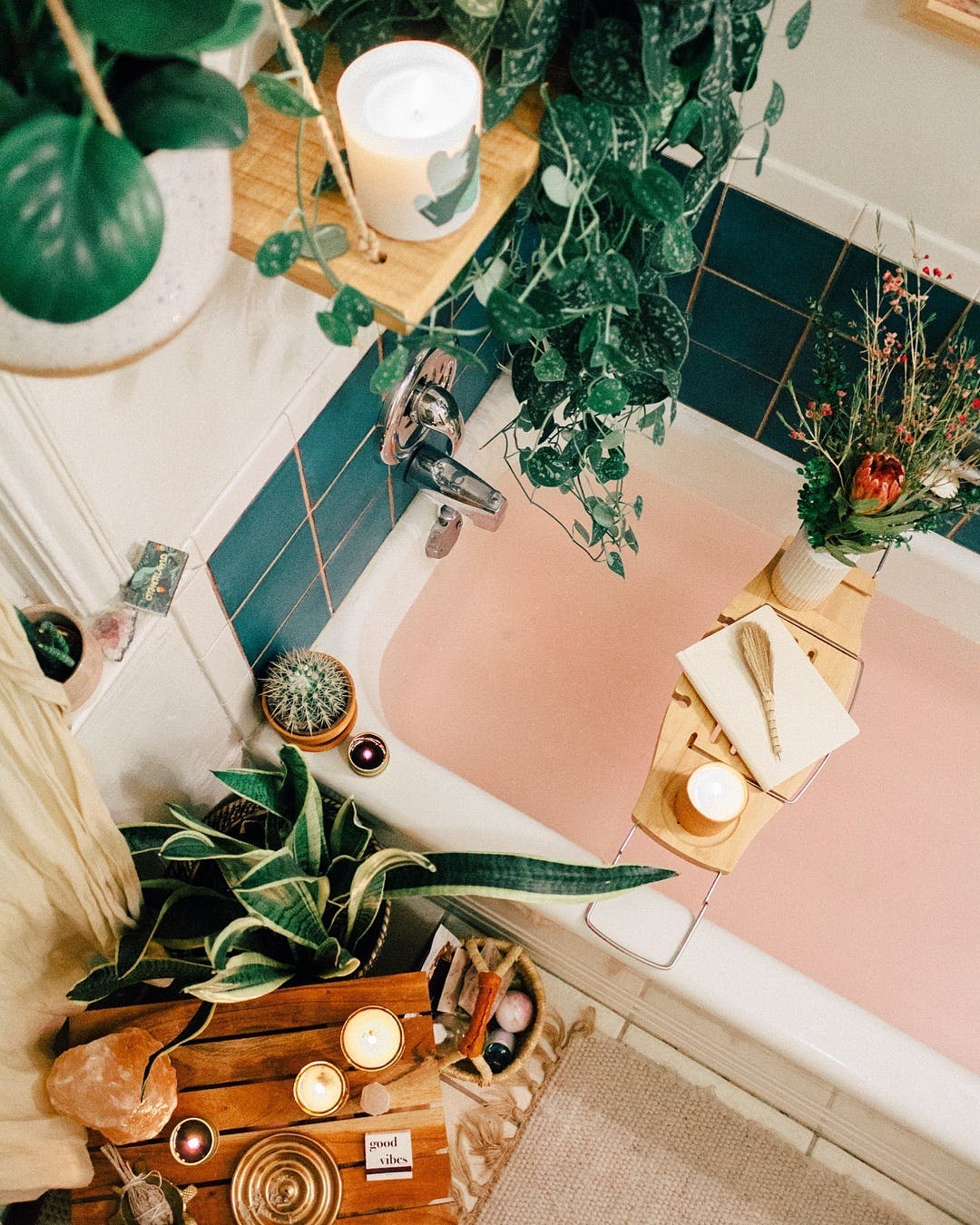 Apologies if this photo is a little hard to make sense of. Its an overhead shot of a bath tub/bathroom. I wanted to include because I love the idea of adorning the bathroom with so many plants.