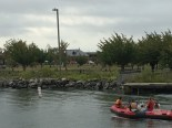 Boaters pause to watch as the runners make their way through Liberty State Park.