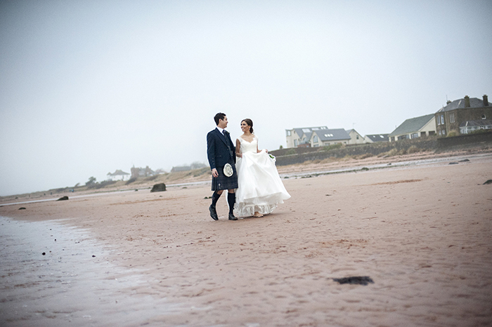 Bride and groom on beach - Jarvie and Jones Photography