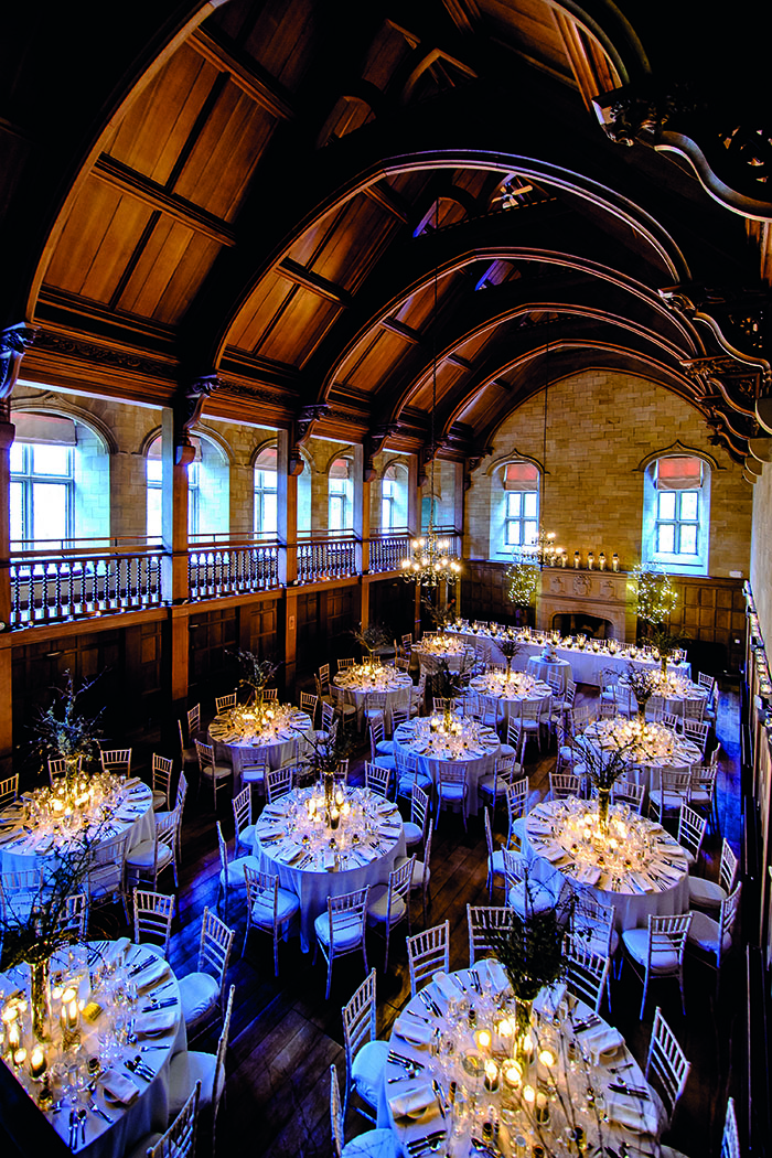 The vaulted ballroom at Achnagairn Castle, set up with tables for dinner