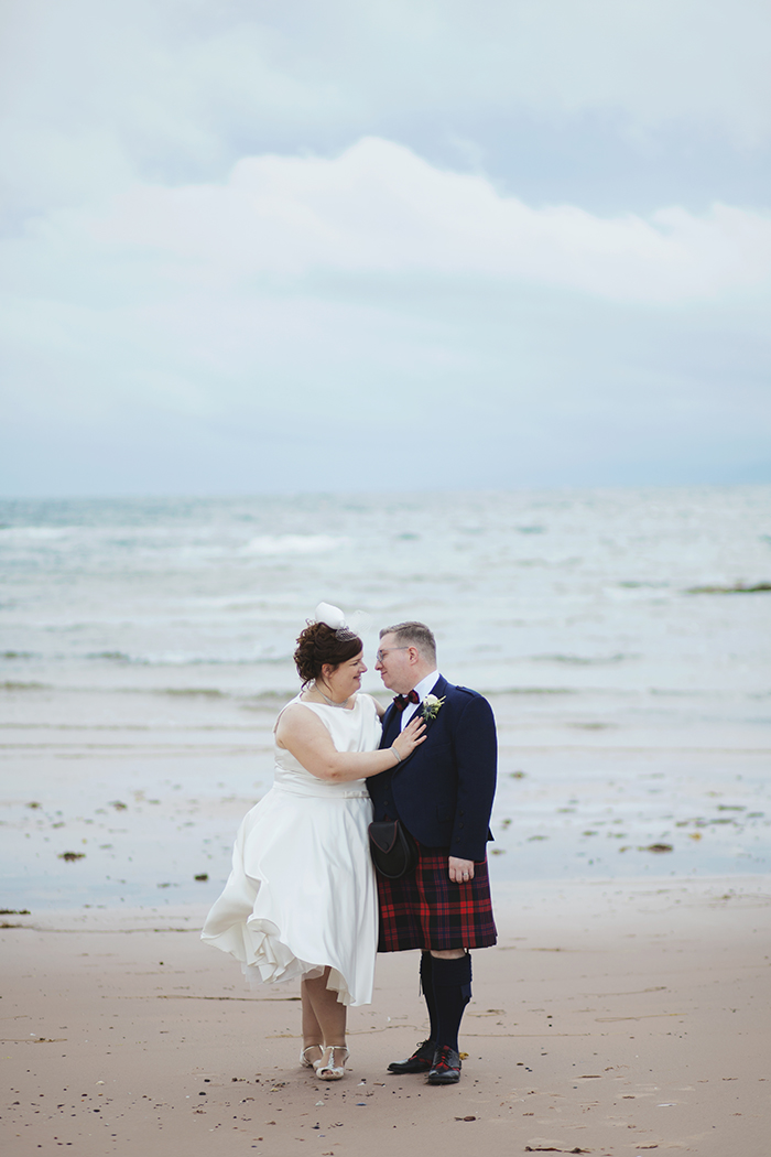 Real Wedding at The Waterside Hotel Ayrshire. Laura A Tiliman Photography. Couple on beach