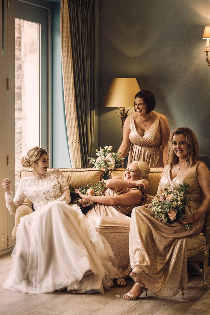 Photos by Zoe rustic PapaKåta tipi wedding - Bride and bridesmaids