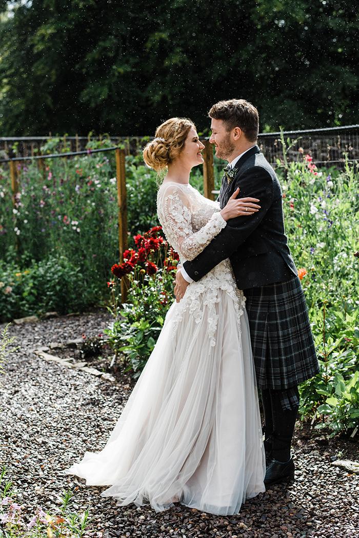 Photos by Zoe rustic PapaKåta tipi wedding - couple embracing