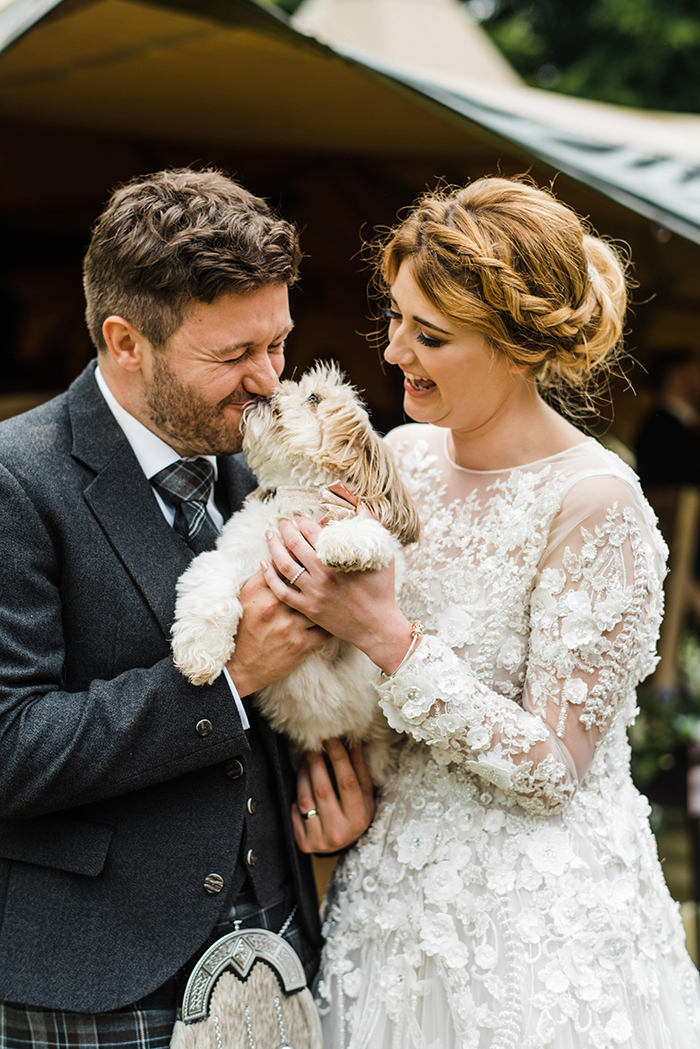 Photos by Zoe rustic PapaKåta tipi wedding - couple and dog