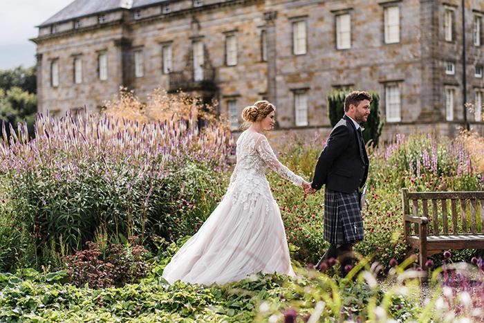 Photos by Zoe rustic PapaKåta tipi wedding - bride and groom