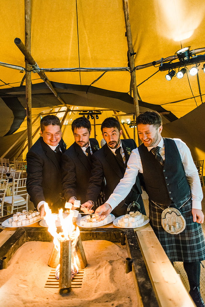 Photos by Zoe rustic PapaKåta tipi wedding - firepit marshmallows