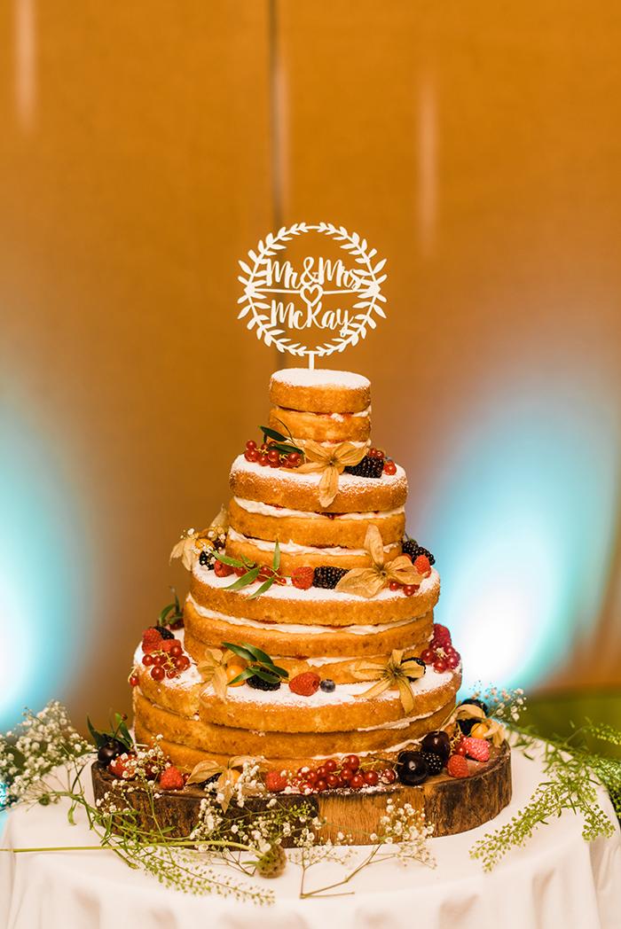 Photos by Zoe rustic PapaKåta tipi wedding - wedding cake