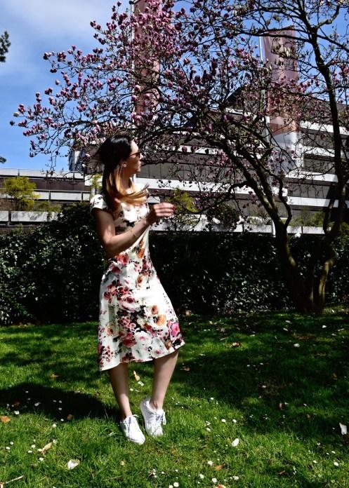 Style details: Floral silk dress - Ann & Line , Sneakers - Burberry, Sunglasses - Prada