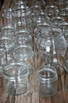 Empty glass jars and bottles will be transformed to the elegant interior decorations