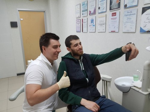 Happy patients don't leave without a selfie with the doctor