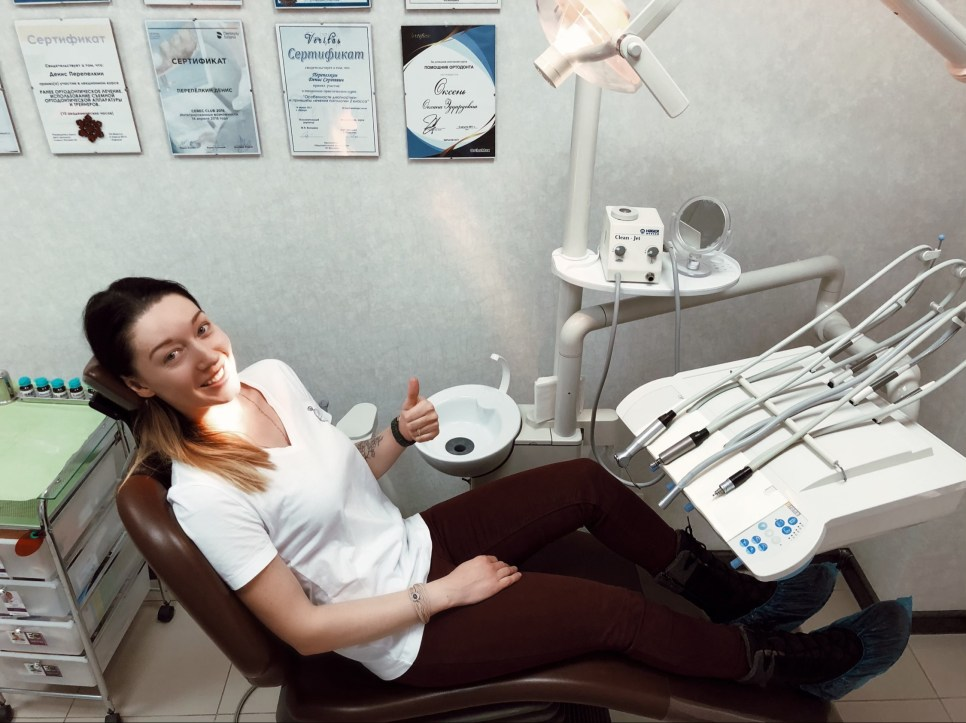 Happy patient in one of the best dental clinics in Kharkov