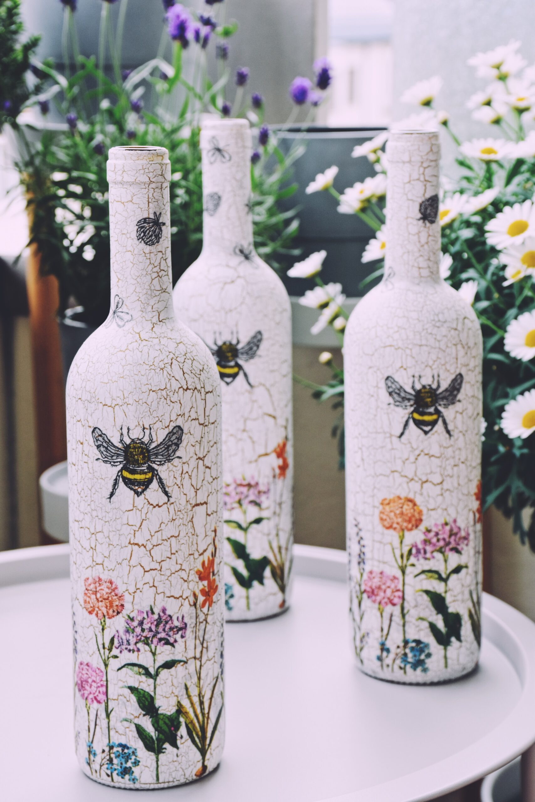 Upcycled glass bottles as watering cans in the urban garden
