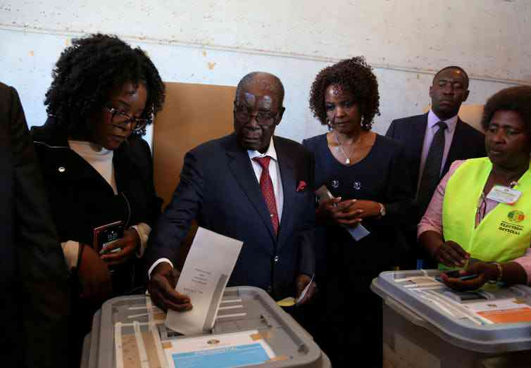 Zimbabwe's election was the first in four decades not to have Robert Mugabe, seen here casting his vote in Harare, on the ballot. Photo credit: Reuters