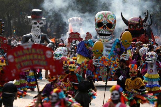 Parade with costumes of cartoonlike skulls for Dia De Los Muertos Celebration.