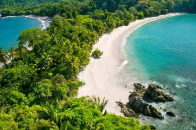 A picturesque aerial view of one of Manuel Antonio's pristine beaches.