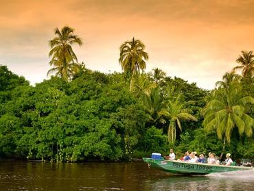 A passing boat charter, one of the only ways to acces Tortuguero National Park.