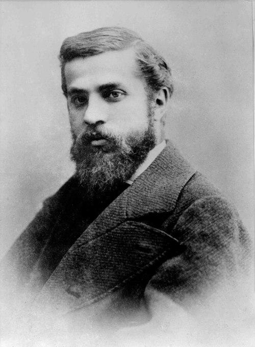 A portrait photograph of Antoni Gaudi.