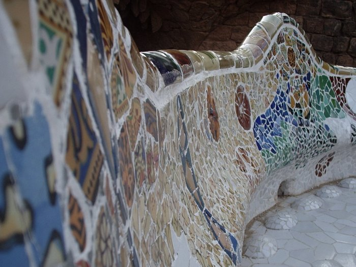 The serpentine bench on the main terrace showcases colorful mosaic work by Gaudi.