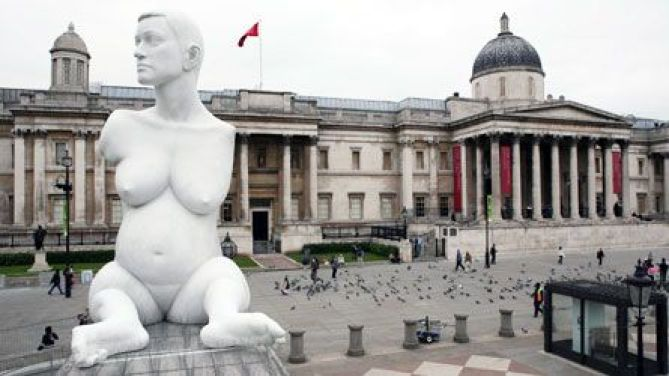 image of the armless pregnant white statue of Alisan Lapper displayed in Trafalgar Suare in London