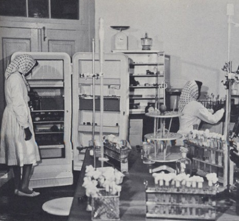 Women working in one of the labs at the Vaccine Research Center pre-Taliban time