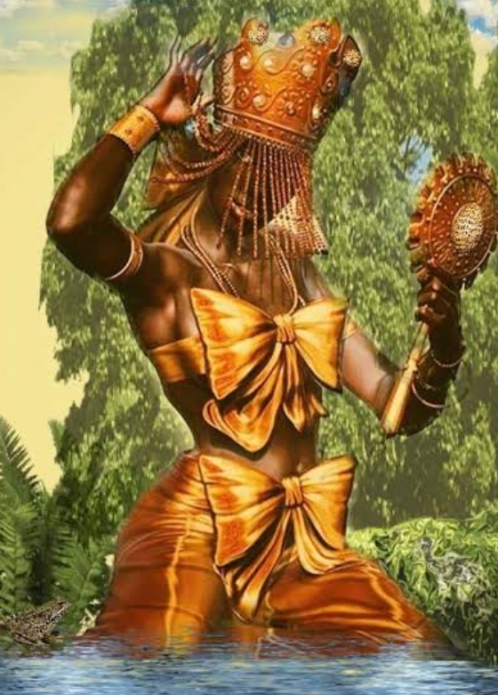 The African goddess called Orisha,dressed in golden colours,with a crown on her head and hold a mirror