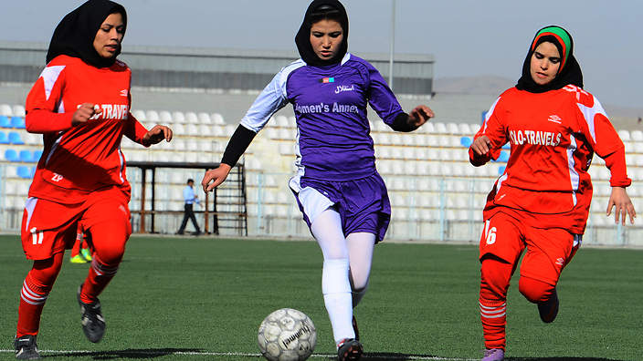 Afghan female football players from Isteghlal (in purple) and Afghan (red) compete during the women's football tournament final match in Kabul on December 6, 2013. Afghan defeated Isteghlal to win the tournament. The month-long women's football tournament, which saw some 16 teams participate, was held to select top players for the Afghan national women's football team.