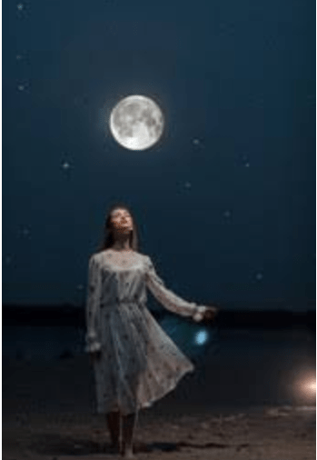 A woman staring at the Moon and feeling the effect