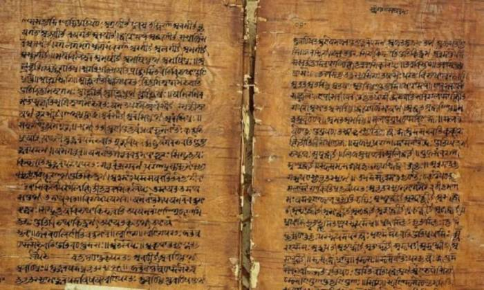 A photograph of one of the recovered Veds, the words in Sanskrit written on parchment. The copy is worn out but still readable..